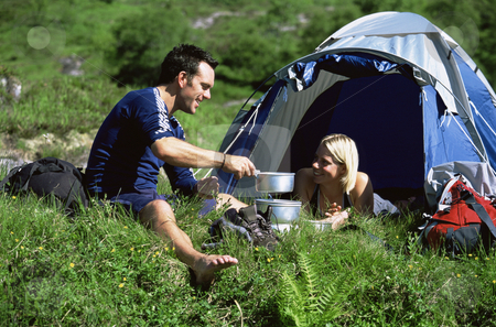 Couple camping in the great outdoors stock photo,  by Monkey Business Images