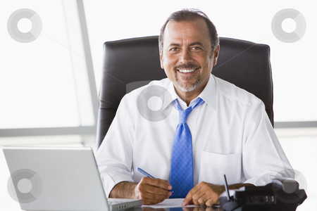 Businessman working at desk stock photo, Businessman working hard at desk by Monkey Business Images