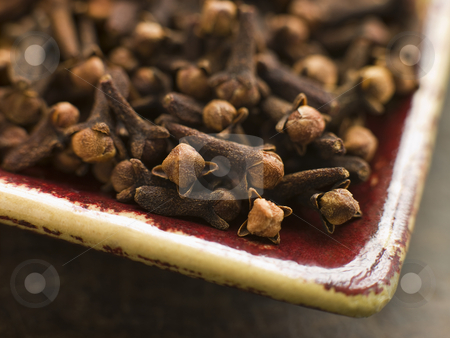 Plate of Whole Cloves stock photo, Close up of Plate of Whole Cloves by Monkey Business Images