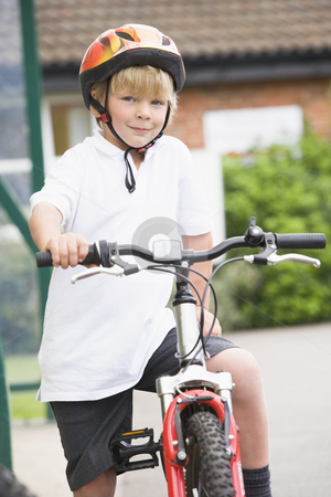 A young boy on a bicycle stock photo,  by Monkey Business Images