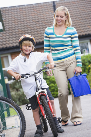 A woman walking her son home from school stock photo,  by Monkey Business Images