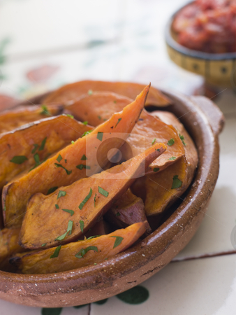 Sweet Potato Wedges with Tomato Salsa stock photo,  by Monkey Business Images