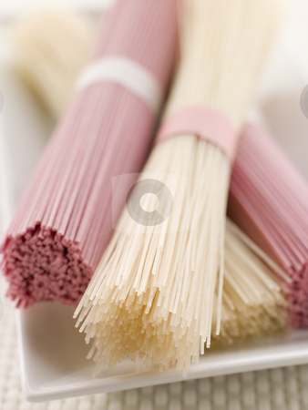 Clear and Pink Dried somen Noodles stock photo, Dish of Clear and Pink Dried somen Noodles tied in bundles by Monkey Business Images