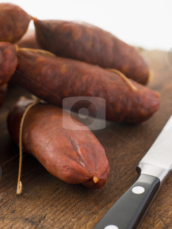 Strings of Chorizo Sausage stock photo,  by Monkey Business Images