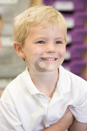 Schoolboy sitting in primary class stock photo,  by Monkey Business Images