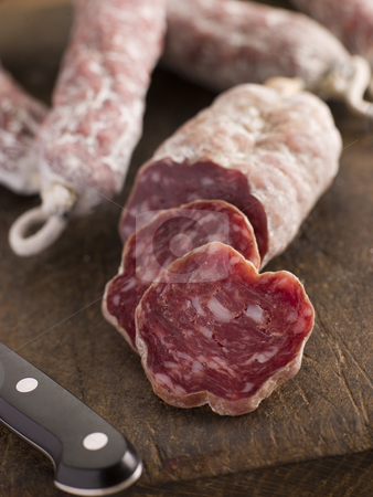 Selection of French Sausages on a cutting board stock photo,  by Monkey Business Images