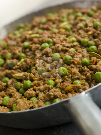 Keema Curry and Peas stock photo, Pan of Keema Curry and Peas by Monkey Business Images