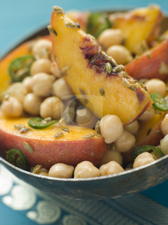Bowl of Chick Pea and Peach Salad stock photo,  by Monkey Business Images