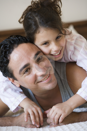A Middle Eastern man with his daughter stock photo,  by Monkey Business Images