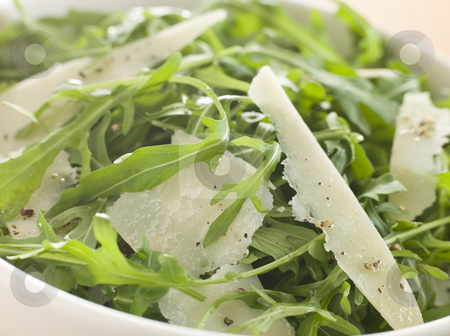 Salad of Roquette Leaves and Parmesan Shavings with Olive Oil stock photo,  by Monkey Business Images