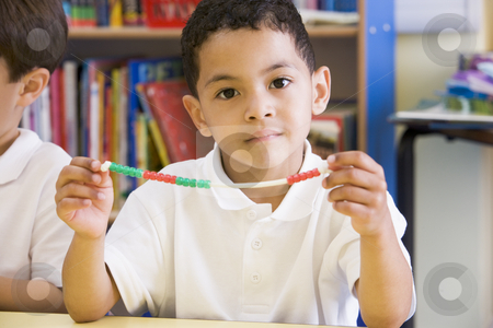 A schoolboy in a primary class stock photo,  by Monkey Business Images