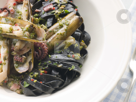 Sauteed Razor Clams with Baby Octopus Pesto and Tagliatelle Nero stock photo, Plate of Sauteed Razor Clams with Baby Octopus Pesto and Tagliatelle Nero by Monkey Business Images