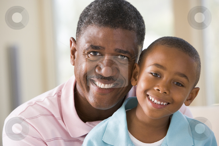 Grandfather and grandson indoors smiling stock photo,  by Monkey Business Images