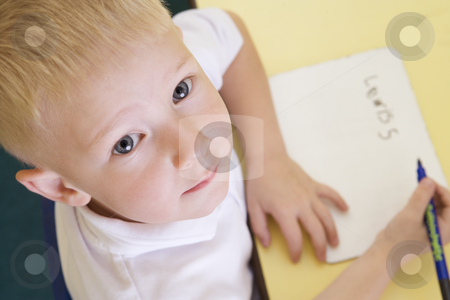 Boy learning to write name in primary class stock photo,  by Monkey Business Images
