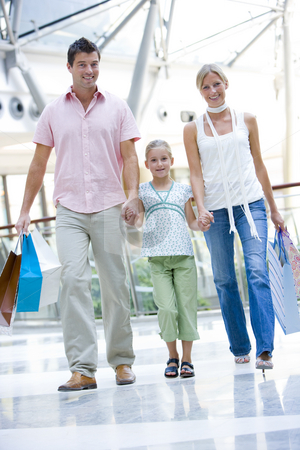 Family shopping in mall stock photo, Family shopping in mall carrying bags by Monkey Business Images