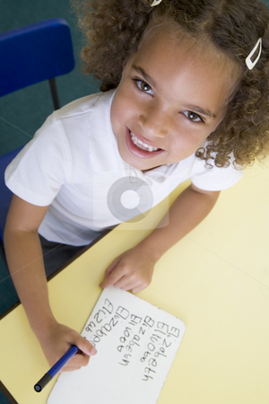 Girl learning to write name in primary class stock photo,  by Monkey Business Images
