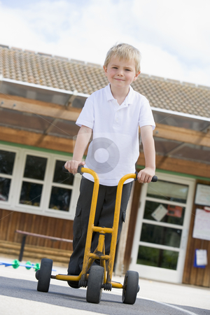 A young boy playing in a playground stock photo,  by Monkey Business Images
