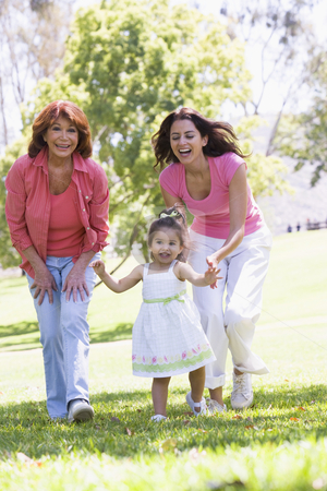 Grandmother with adult daughter and granddaughter in park stock photo,  by Monkey Business Images