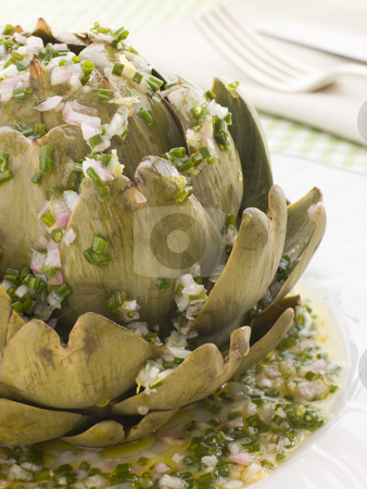Warm Globe Artichoke Vinaigrette stock photo, Plate of Warm Globe Artichoke with Vinaigrette by Monkey Business Images