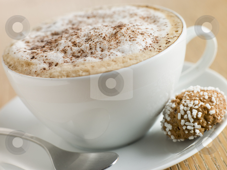 Cup of Cappucino with an Amaretti Biscuit stock photo, Close up of Cup of Cappucino with an Amaretti Biscuit by Monkey Business Images