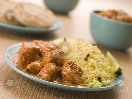 Plated Chicken Korma with Pilau Rice and Naan bread stock photo,  by Monkey Business Images