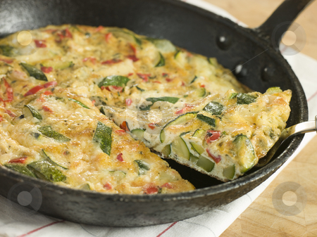 Slice of Courgette Fritatta stock photo,  by Monkey Business Images