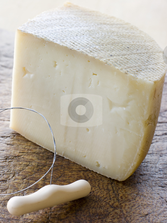 Wedge of Pecorino Cheese stock photo, Wedge of Pecorino Cheese with cheese slice by Monkey Business Images