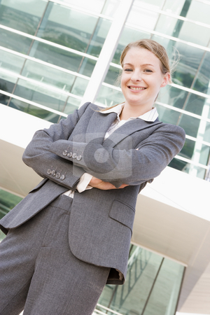 Businesswoman standing outdoors smiling stock photo,  by Monkey Business Images