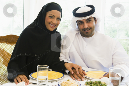 A Middle Eastern couple enjoying a meal  stock photo,  by Monkey Business Images