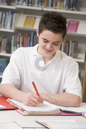 Student studying in library stock photo,  by Monkey Business Images