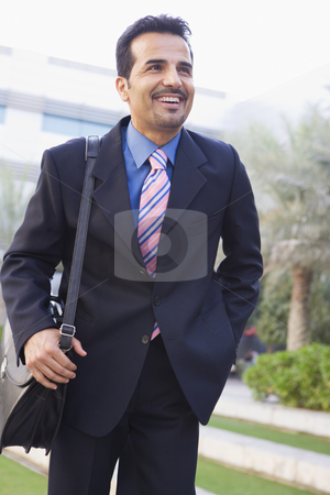 Businessman walking to office stock photo, Businessman walking to office carrying briefcase by Monkey Business Images