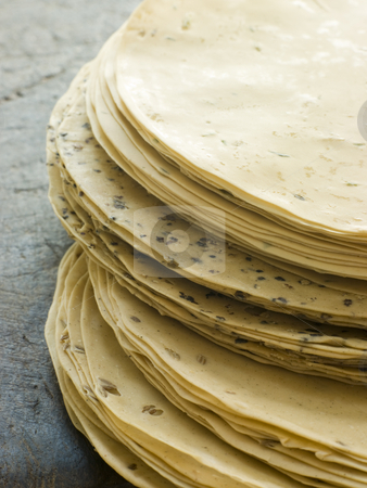 Stack of uncooked Papadoms stock photo, Close up of Stack of uncooked Papadoms by Monkey Business Images
