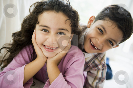 Portrait of a Middle Eastern brother and sister stock photo,  by Monkey Business Images