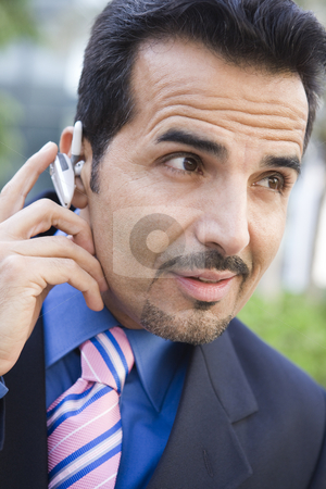 Businessman using bluetooth earpiece stock photo, Businessman using bluetooth earpiece outside by Monkey Business Images