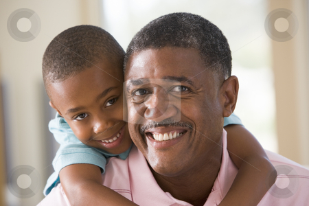 Grandfather and grandson smiling stock photo,  by Monkey Business Images
