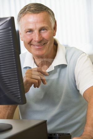 Senior man working on a computer stock photo,  by Monkey Business Images