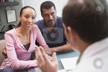 Couple having discussion with doctor in IVF clinic stock photo, Couple having discussion with doctor in IVF clinic sitting at desk by Monkey Business Images