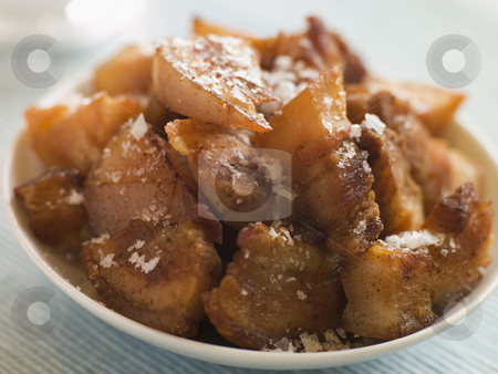 Dish of Chicharrones with Sea Salt Flakes stock photo,  by Monkey Business Images