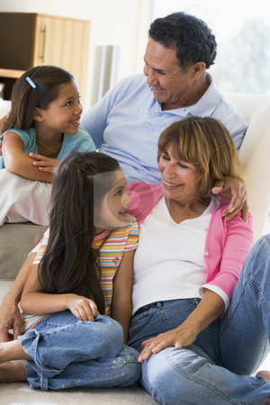 Grandparents talking with grandchildren stock photo,  by Monkey Business Images