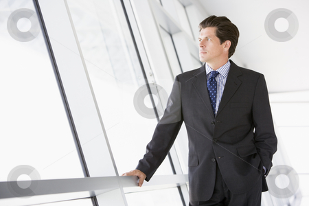 Businessman standing in corridor stock photo,  by Monkey Business Images
