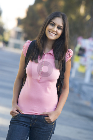 University student wearing rucksack stock photo, Female student wearing rucksack off campus by Monkey Business Images