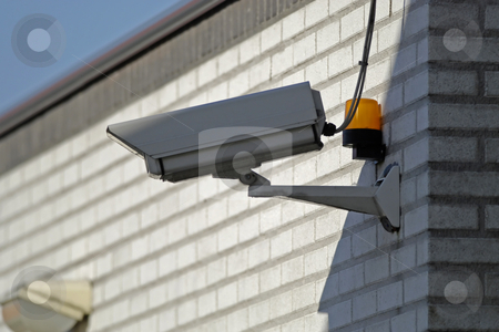 Surveillance camera stock photo, Security camera mounted a brick building by Gert-Jan Kappert