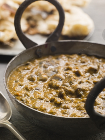 Kali Dahl Served in a Karahi With Naan Bread stock photo, Close up of Kali Dahl Served in a Karahi With Naan Bread by Monkey Business Images
