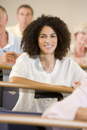 Female adult student listening to a university lecture stock photo,  by Monkey Business Images