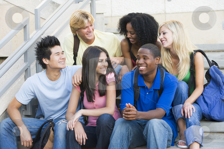Group of university students sitting on steps stock photo, Group of six students sitting on outside on stairs by Monkey Business Images