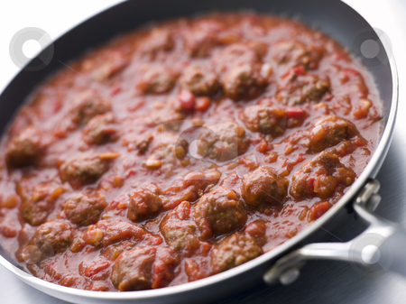 Meatballs in a Tomato Sauce stock photo, Pan of Meatballs in a Tomato Sauce by Monkey Business Images