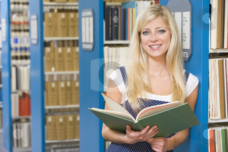 University student studying in library stock photo, University student studying book in library by Monkey Business Images