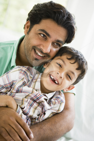 A Middle Eastern man with his son stock photo,  by Monkey Business Images