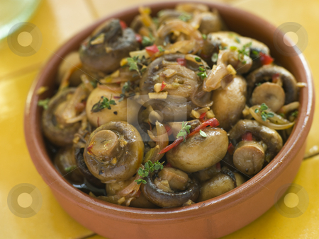 Garlic and Chilli Marinated Mushrooms stock photo,  by Monkey Business Images