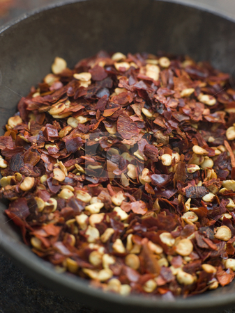 Dish of Dried Chili Flakes stock photo, Close up of Dish of Dried Chili Flakes by Monkey Business Images